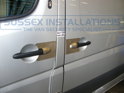 Front passenger door and side load door pictured with Armaplate Sentinel and you can see the Locks 4 Vans T Series Deadlock in the top of the picture. - Mercedes - Sprinter - Sprinter (2006 - 2013) W906 - Armaplate SENTINEL VAN HANDLE GUARDS - Online Shop & Worldwide Delivery - Sussex - London & The South East