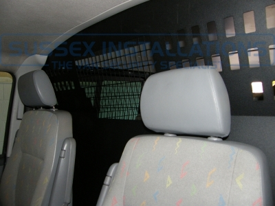 Picture of the bulkhead that we fitted from the front seats. - VW - Transporter / Caravelle (null/nul) - VW Transporter T32 TDI Bulkhead and Window Grill - Online Shop & Worldwide Delivery - Sussex - London & The South East