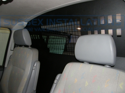 Note the bulkhead has a punched holded area so that communication can be maintained with rear passengers and the interior mirror can still be used. - VW - Transporter / Caravelle (null/nul) - VW Transporter T32 TDI Bulkhead and Window Grill - Online Shop & Worldwide Delivery - Sussex - London & The South East