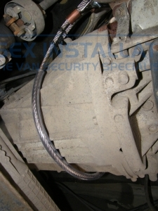 Armacat Catalytic converter pictured chained to the gearbox. - Ford - Transit - Transit MK7 (07-2014) - Slamlocks - Online Shop & Worldwide Delivery - Sussex - London & The South East