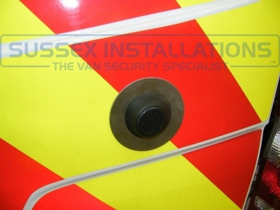 This is a strong stainless steel plate that is designed to protect against the internal handle being release by a screw driver being pushed through the thin Mercedes sheet metal near the magnet. - Mercedes - Sprinter - Sprinter (2006 - 2013) W906 - Sussex Installations MER1-RB-SHIELD2 - Online Shop & Worldwide Delivery - Sussex - London & The South East