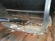 Behind the dust cart blades prior to the removal of stray rubbish  - Dust Cart - Behind Blade Dig Out and Pressure Wash - Eastbourne - Sussex, Surrey, Kent
